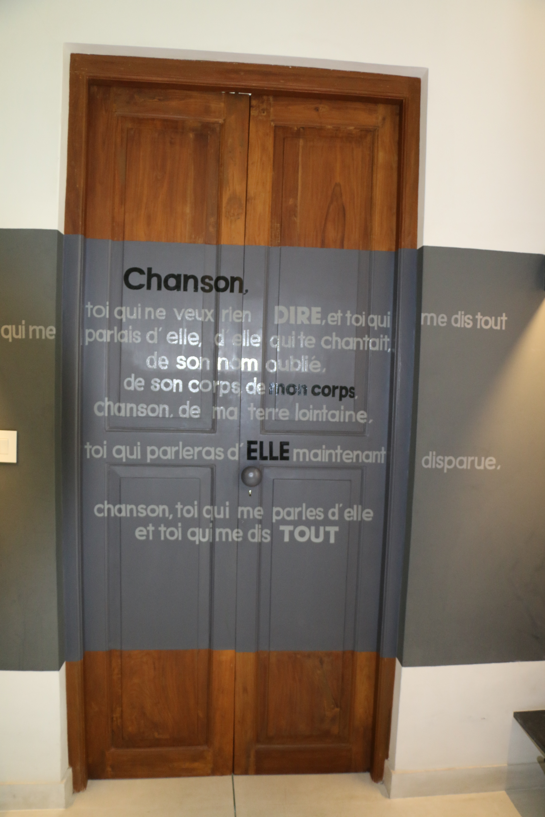 back in the hotel my room was elegant and as usual i just loved the bathroom the bathroom door had the lyrics of a song from a 1975 french drama called - Medium Hardwood Hotel 2015